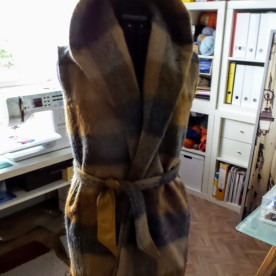 shawl pulled up on trench